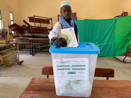 A man casts his vote at a polling station during presidential election in Nouakchott
