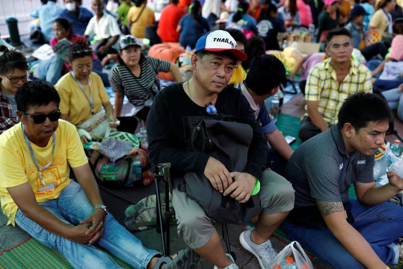 Family members in the fishing industry sit at a protest outside the Agriculture Ministry in Bangkok