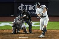 New York Yankees' Giancarlo Stanton hits an RBI single during the eighth inning of a baseball game against the Houston Astros Wednesday, May 5, 2021, in New York. The Yankees won 6-3. (AP Photo/Frank Franklin II)