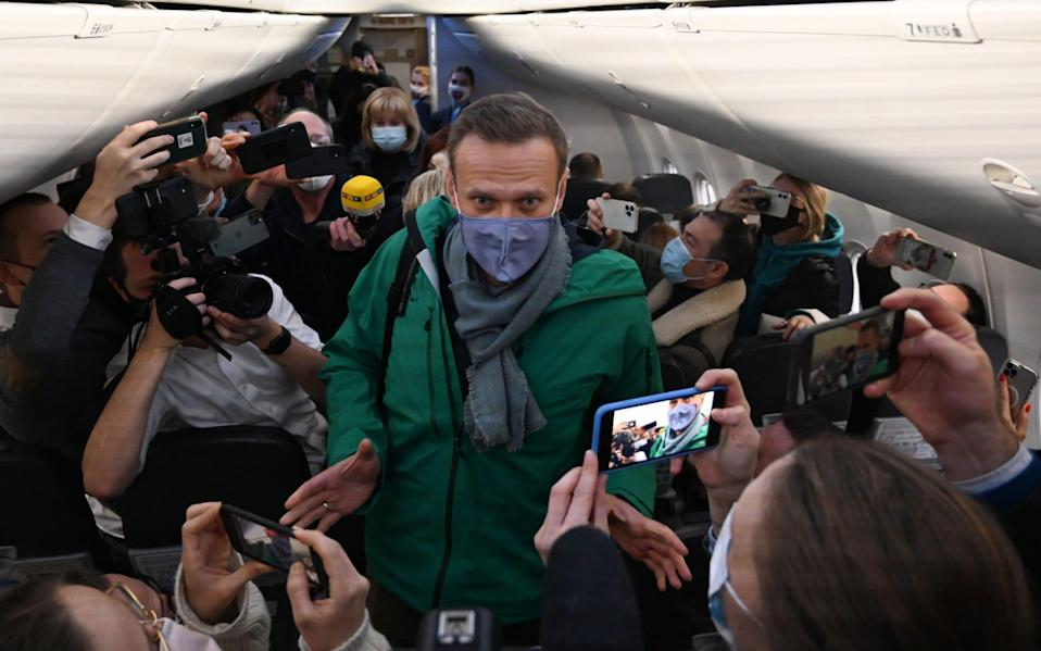 Alexei Navalny on the plane heading to Moscow -  KIRILL KUDRYAVTSEV/AFP
