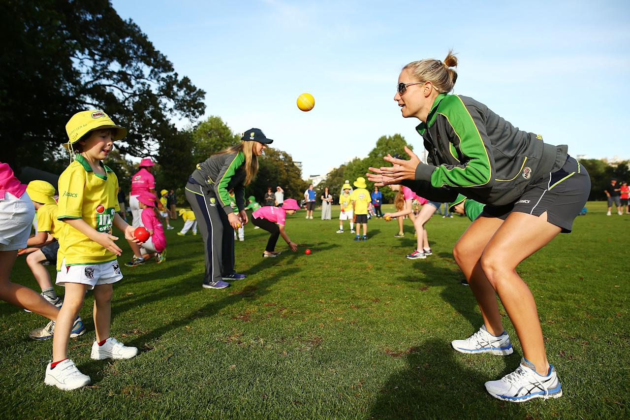SYDNEY, AUSTRALIA - SEPTEMBER 30:  Alyssa Healy plays cricket with young participants during the launch for Cricket Australia's junior sports program MILO in2CRICKET at Rushcutters Bay Park on September 30, 2013 in Sydney, Australia.  (Photo by Matt King/Getty Images)