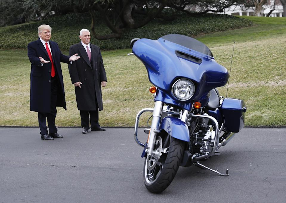 President Donald Trump and Vice President Mike Pence stop to admire a Harley Davidson motorcycle parked on the South Lawn of the White House in Washington, Thursday, Feb. 2, 2017. (AP Photo/Pablo Martinez Monsivais)