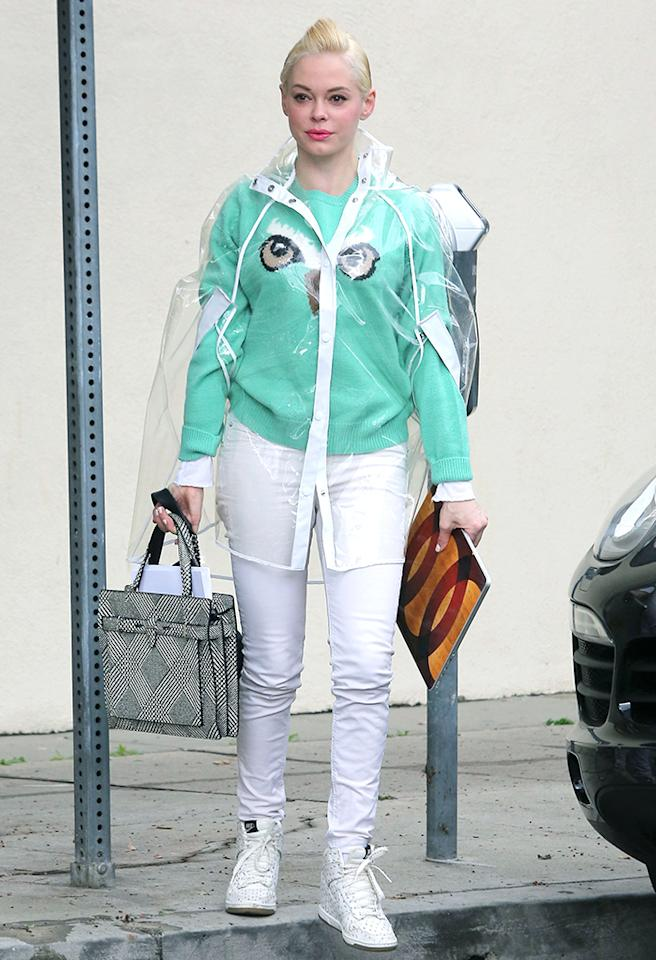 """Charmed"" alum Rose McGowan was photographed heading to the hair salon in this wacky, bad-weather gear on Thursday afternoon in rainy Los Angeles. Covering her mint-green owl sweater was a transparent, button-down cape. A sleek updo, white skinny jeans and matching retro high tops completed her futuristic fashion faux pas ... not that she gives a hoot about being featured in What Were They Thinking?!. (3/7/2013)"