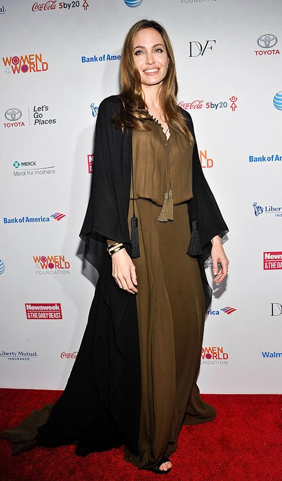 "Her hair and makeup were flawless, but what on Earth was Angelina Jolie thinking when she decided to don this shapeless, tassel-adorned Saint Laurent snafu to Thursday's Women in the World Summit? In addition to the mud-colored maxi dress, Brad Pitt's better half appeared to be wearing the cloak portion of her costume from the upcoming Disney feature ""Maleficent,"" in which the actress portrays Sleeping Beauty's arch nemesis, The Mistress of All Evil. (4/4/2013)"