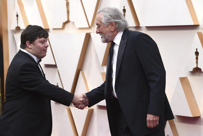 Zack Gottsagen, left, and Robert De Niro arrive at the Oscars on Sunday, Feb. 9, 2020, at the Dolby Theatre in Los Angeles. (Photo by Jordan Strauss/Invision/AP)