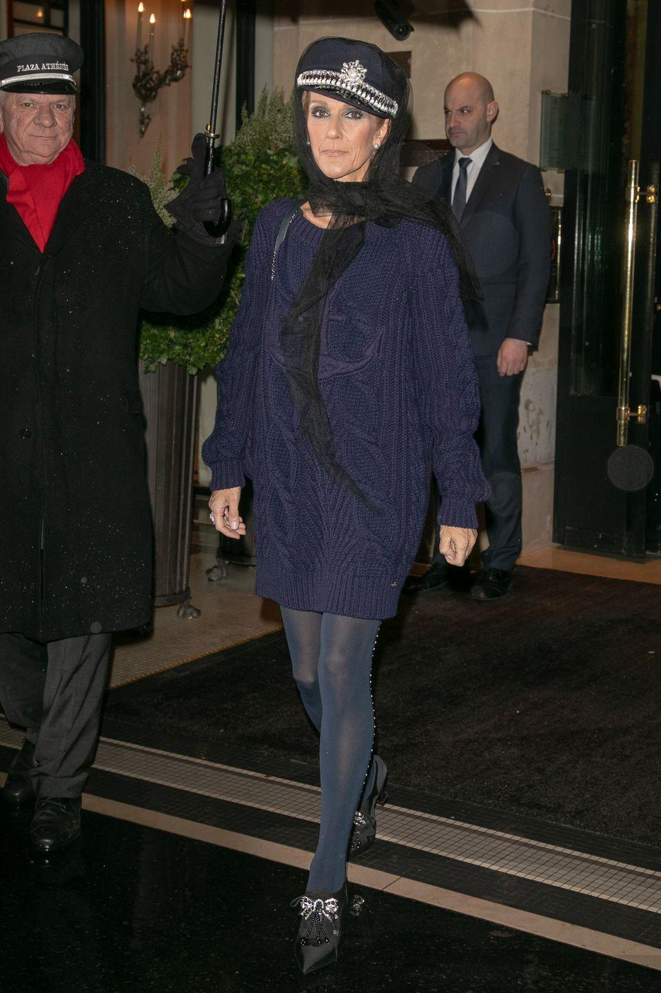 <p>Hello, 911? Dion slayed yet again while out in Paris. This time, she donned an embellished newsboy cap and navy blue sweater dress look. </p>