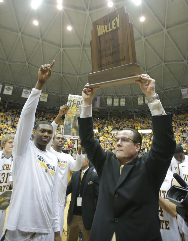 Wichita State coach Gregg Marshall holds up the Missouri Valley Conference regular season trophy after beating Missouri State 68-45 in an NCAA college basketball game in Wichita, Kansas., Saturday, March 1, 2014. (AP Photo/The Wichita Eagle, Travis Heying) LCOAL TV OUT; MAGS OUT; LOCAL RADIO OUT; LOCAL INTERNET OUT