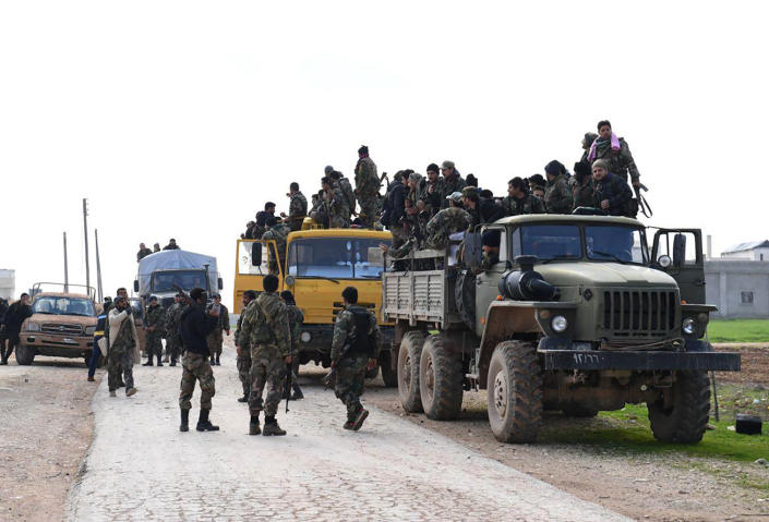 In this photo released Wednesday Feb. 5, 2020 by the Syrian official news agency SANA, shows Syrian government forces entering the village of Tel-Sultan, in Idlib province, northwest Syria. On Thursday, State media and opposition activists said Turkey has sent more reinforcements into northwestern Syria, setting up new positions in an attempt to stop a government offensive on the last rebel stronghold in the war-torn country. (SANA via AP)
