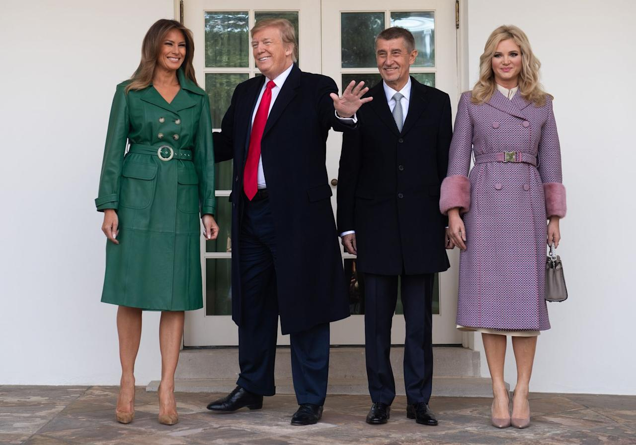 <p>The President and First Lady posed outside the White House with Czech Republic Prime Minister Andrej Babiš and his wife, Monika Babišová. Melania wore a green leather trench coat by Alexa Chung and tan suede Christian Louboutins.</p>