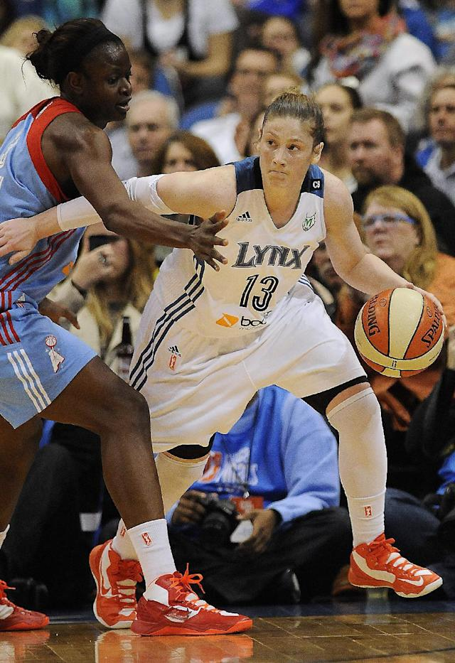 Minnesota Lynx guard Lindsay Whalen, right, pushes the ball past Atlanta Dream forward Aneika Henry during Game 1 of the WNBA basketball finals, Sunday, Oct. 6, 2013, in Minneapolis. The Lynx won 84-59. (AP Photo/Stacy Bengs)