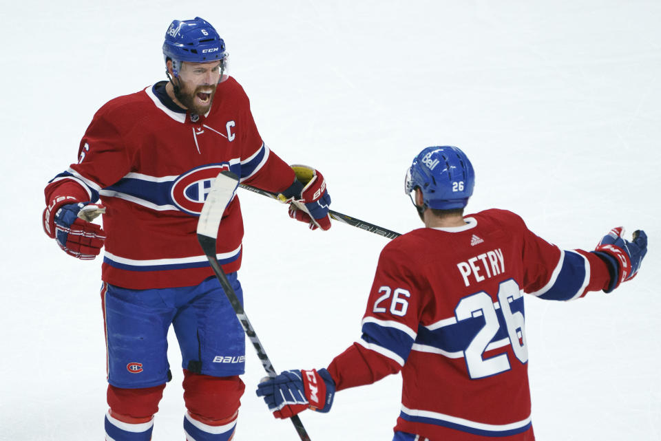 Montreal Canadiens' Shea Weber (6) celebrates his goal with teammate Jeff Petry during the first period in Game 6 of an NHL hockey Stanley Cup semifinal playoff series against the Vegas Golden Knights Thursday, June 24, 2021 in Montreal. (Paul Chiasson/The Canadian Press via AP)