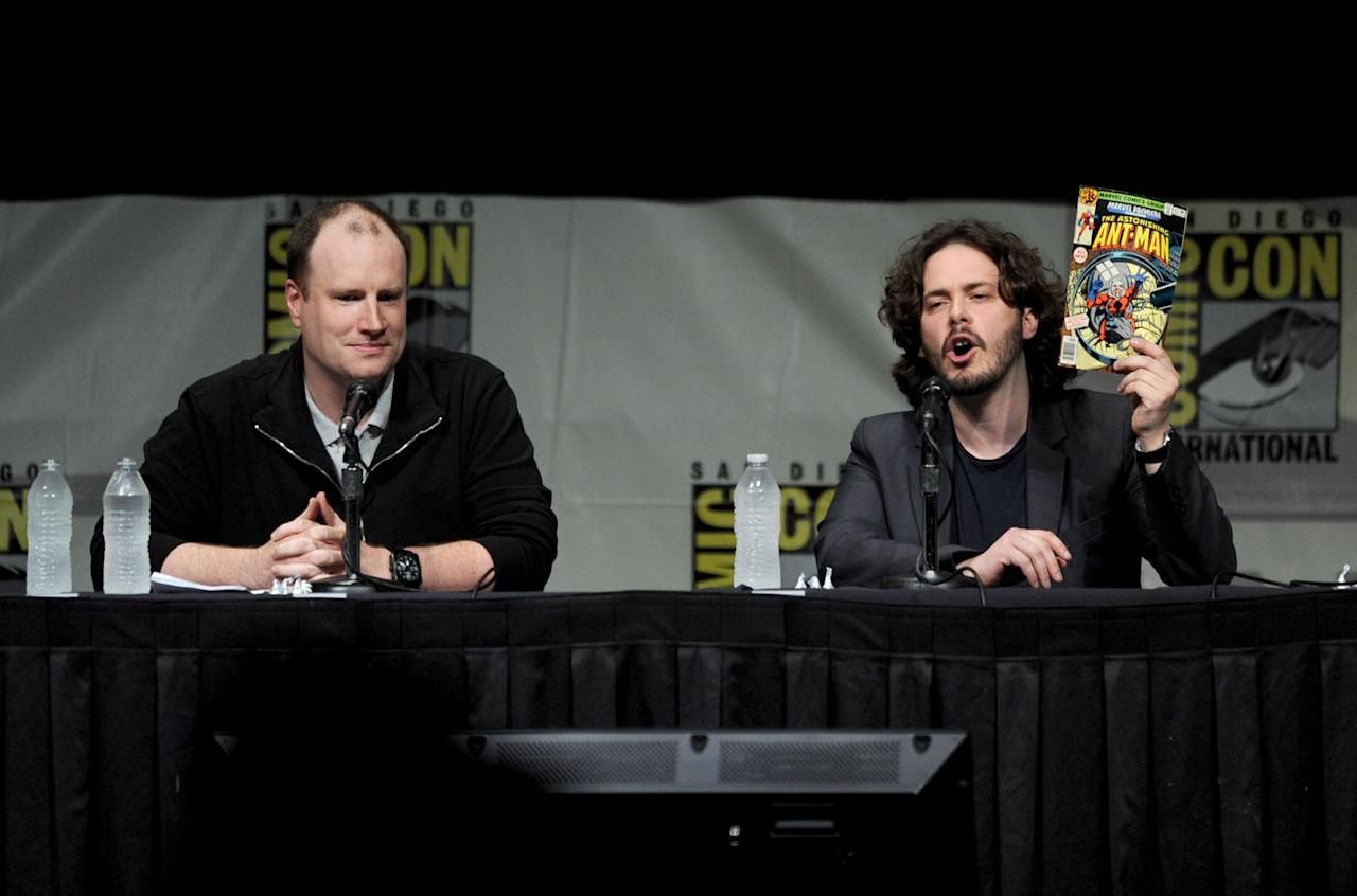 """SAN DIEGO, CA - JULY 14:  Producer Kevin Feige (L) and writer Steven Wright speak at Marvel Studios """"Iron Man 3"""" panel during Comic-Con International 2012 at San Diego Convention Center on July 14, 2012 in San Diego, California.  (Photo by Kevin Winter/Getty Images)"""