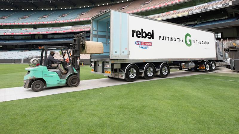 Part of the MCG turf can be seen getting loading into a temperature-controlled truck.