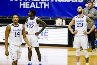 Seton Hall's Sandro Mamukelashvili (23), Myles Cale (22) and Jared Rhoden (14) react during the second half of an NCAA college basketball game against the Creighton Wednesday, Jan. 27, 2021, in Newark, N.J. Creighton won 85-81. (AP Photo/Frank Franklin II)
