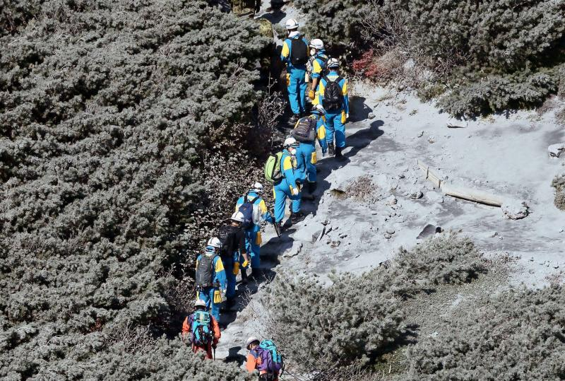 Rescuers climb up Mount Ontake, which straddles Nagano and Gifu prefectures, for rescue operations, central Japan