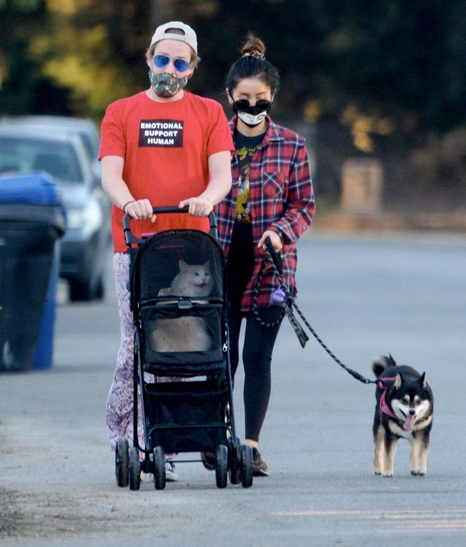 <p>Macaulay Culkin and girlfriend Brenda Song take their cat and dog out for a walk in L.A. on Tuesday.</p>