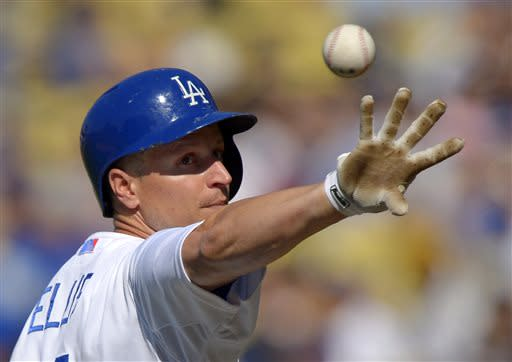 Los Angeles Dodgers' Mark Ellis tosses the ball back after being hit by a pitch during the first inning of a baseball game against the Colorado Rockies, Saturday, July 13, 2013, in Los Angeles. (AP Photo/Mark J. Terrill)