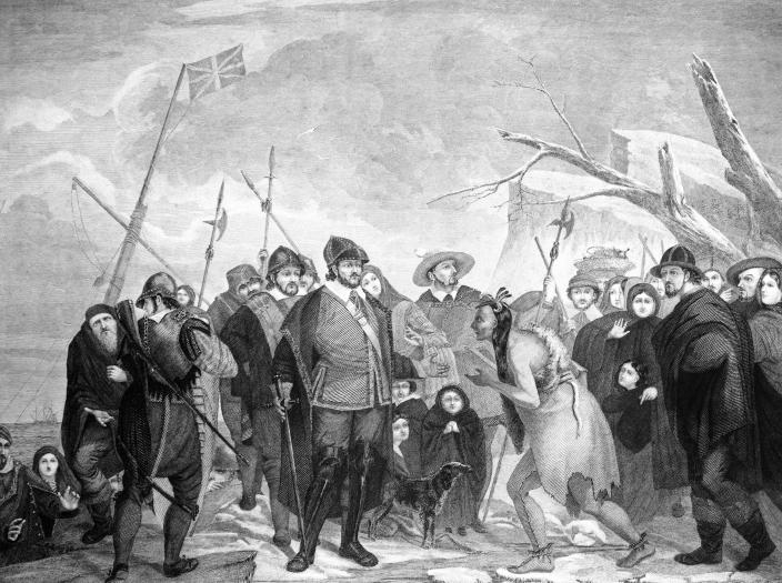 IMage: The 1620 landing of pilgrim colonists at Plymouth Rock, MA. (Charles Phelps Cushing/ClassicStock / Getty Image)
