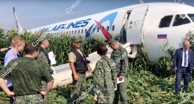 Authorities at the scene of Ural Airlines plane emergency landing in a Moscow cornfield.
