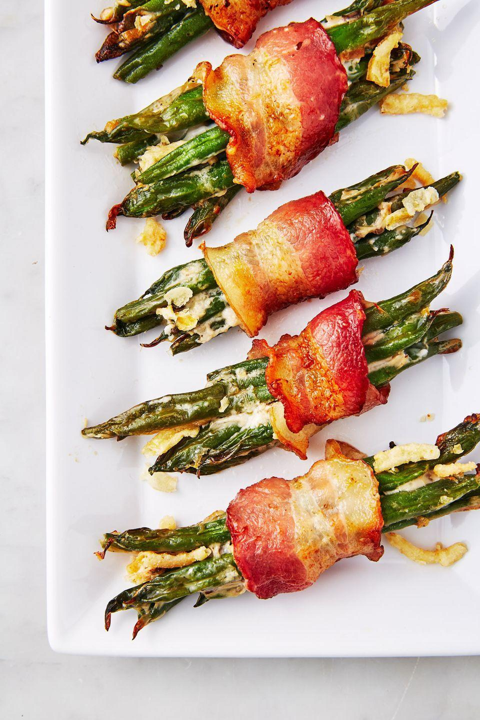"""<p>An individual portion of bacon? Yes please!</p><p>Get the recipe from <a href=""""https://www.delish.com/cooking/recipe-ideas/recipes/a50049/green-bean-casserole-bundles-recipe/"""" rel=""""nofollow noopener"""" target=""""_blank"""" data-ylk=""""slk:Delish"""" class=""""link rapid-noclick-resp"""">Delish</a>.</p>"""