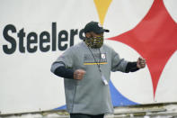 Pittsburgh Steelers head coach Mike Tomlin celebrates after an NFL football game against the Indianapolis Colts, Sunday, Dec. 27, 2020, in Pittsburgh. (AP Photo/Gene J. Puskar)