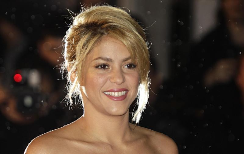 "FILE - In this Jan. 28, 2012 file photo, Colombian singer, songwriter, musician, Shakira arrives at the Cannes festival palace, to take part in the NRJ Music awards ceremony, in Cannes, southeastern France. NBC announced Monday, Sept. 17, 2012 that Usher and Shakira are joining ""The Voice"" as new coaches next spring, when Christina Aguilera and CeeLo Green take a break from the show. (AP Photo/Lionel Cironneau, File)"