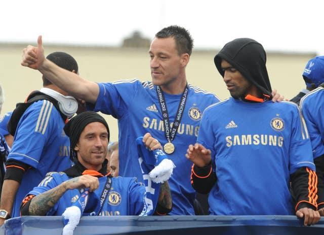 Chelsea captain John Terry, centre, missed the final in Munich due to suspension