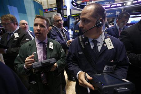 Traders work on the floor of the New York Stock Exchange at the opening of the trading session in New York