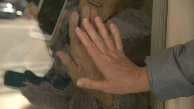 After more than a year, some are still limited to window visits with loved ones in long-term care.  (Pierre Fournier/CBC - image credit)
