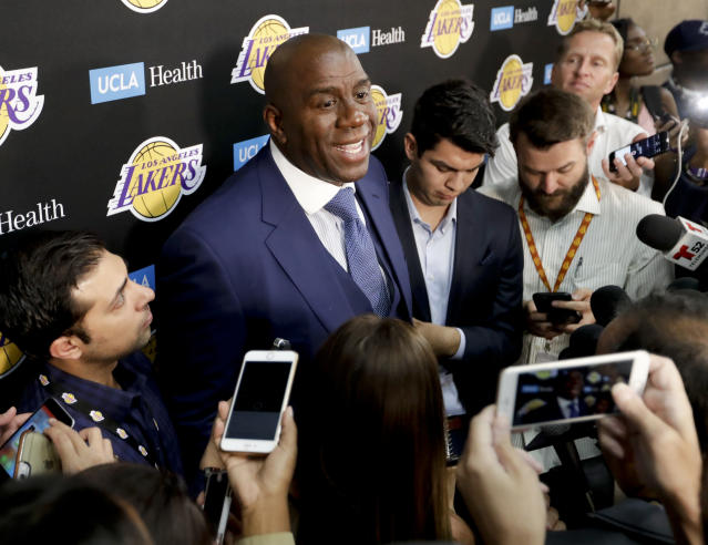 Magic Johnson meets with the media prior to his first season as Lakers president. (AP)