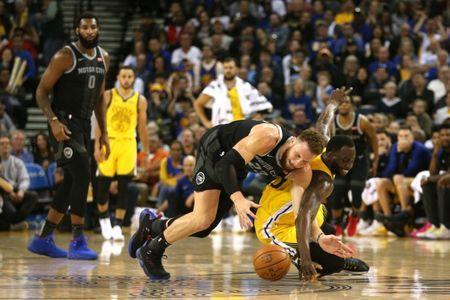 Mar 24, 2019; Oakland, CA, USA; Golden State Warriors forward Draymond Green (23) and Detroit Pistons forward Blake Griffin (23) battle for a loose ball in the third quarter at Oracle Arena. Mandatory Credit: Cary Edmondson-USA TODAY Sports