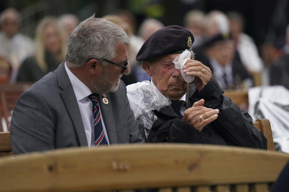 A veteran reacts, while watching the official opening of the British Normandy Memorial in France via a live feed, during a ceremony at the National Memorial Arboretum in Alrewas, England, Sunday, June 6, 2021. Several ceremonies are scheduled on Sunday to commemorate the 77th anniversary of D-Day that led to the liberation of France and Europe from the German occupation. On June 6, 1944, more than 150,000 Allied troops landed on code-named beaches, carried by 7,000 boats. (Jacob King/PA via AP)