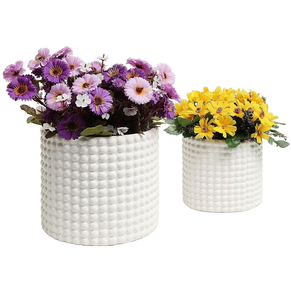 <p>These <span>MyGift Ceramic Vintage-Style Hobnail Textured Flower Planters (Set of 2)</span> ($27, originally $30) make a great gift.</p>