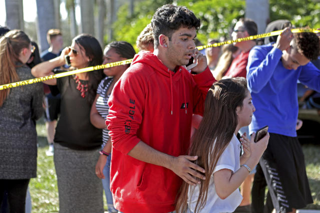 <p>Students released from a lockdown are overcome with emotion following following a shooting at Marjory Stoneman Douglas High School in Parkland, Fla., Feb. 14, 2018. (Photo: John McCall/South Florida Sun-Sentinel via AP) </p>