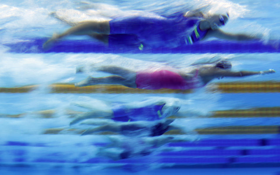 Athletes compete during the women's 1500 meters freestyle preliminaries at the European Aquatics Championships in Duna Arena in Budapest, Hungary, Thursday, May 20, 2021. (AP Photo/Petr David Josek)