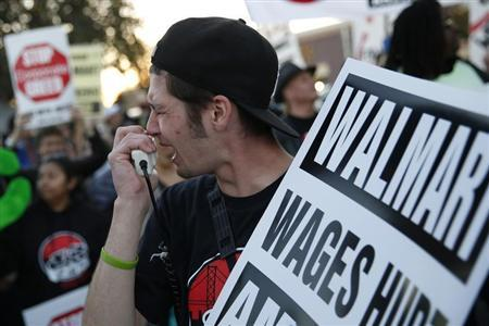 A man chants outside Wal-Mart during a protest for better wages and working conditions during Black Friday in San Leandro, California