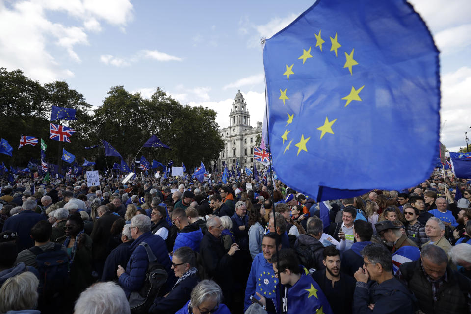 """FILE - In this Saturday, Oct. 19, 2019 file photo Anti-Brexit remain in the European Union supporters gather after taking part in a """"People's Vote"""" protest march calling for another referendum on Britain's EU membership, in Parliament Square in London. Britain and the European Union have struck a provisional free-trade agreement that should avert New Year's chaos for cross-border commerce and bring a measure of certainty to businesses after years of Brexit turmoil. The breakthrough on Thursday, Dec. 24, 2020 came after months of tense and often testy negotiations that whittled differences down to three key issues: fair-competition rules, mechanisms for resolving future disputes and fishing rights. (AP Photo/Matt Dunham, File)"""
