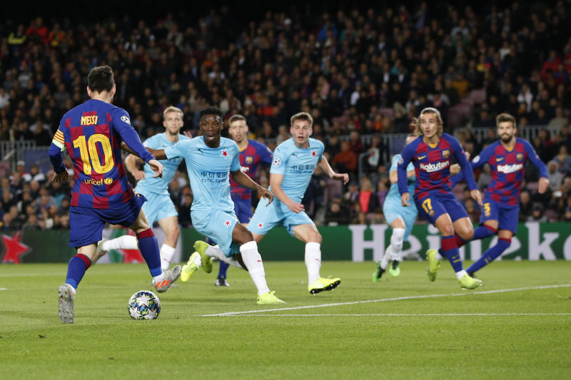 Barcelona's Lionel Messi, left, controls the ball during a Champions League Group F soccer match between Barcelona and Slavia Praha at Camp Nou stadium in Barcelona, Spain, Tuesday, Nov. 5, 2019. (AP Photo/Joan Monfort)