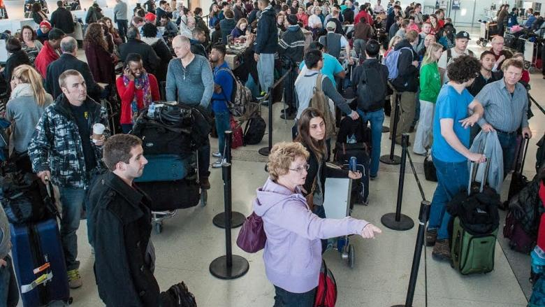 Passengers at Toronto's Pearson International Airport spent hours in long lines Tuesday dealing with weather-related delays. The airport is warning there could be more problems on Wednesday.