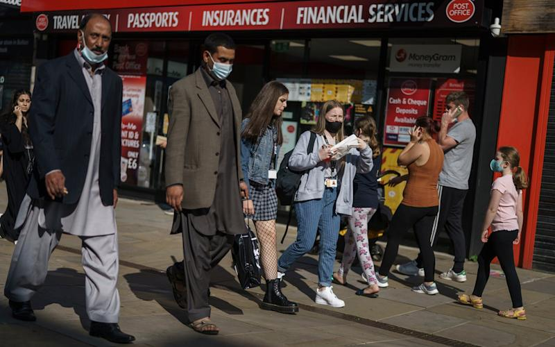 Shoppers go about their business in the High Street on September 21, 2020 in Bolton, United Kingdom - Christopher Furlong/Getty Images