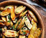 "Use the largest skillet you have (a straight-sided 12"" is ideal) and a fish spatula for this fingerling potato recipe—the thin angled edge is just right for helping potatoes release from the skillet. <a href=""https://www.bonappetit.com/recipe/lemon-and-parsley-skillet-roasted-fingerling-potatoes?mbid=synd_yahoo_rss"" rel=""nofollow noopener"" target=""_blank"" data-ylk=""slk:See recipe."" class=""link rapid-noclick-resp"">See recipe.</a>"