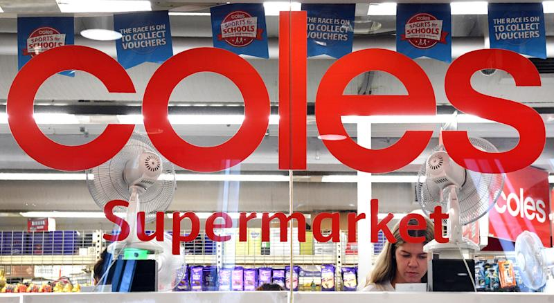 A woman is seen shopping at a Coles supermarket in the central business district of Sydney on March 16, 2018. Australian supermarket chain Coles will be spun off into a separate entity by owner Wesfarmers, the company said on March 16, amid a shake-up in the food retail sector as new entrants threaten a longstanding duopoly. / AFP PHOTO / William WEST (Photo credit should read WILLIAM WEST/AFP via Getty Images)