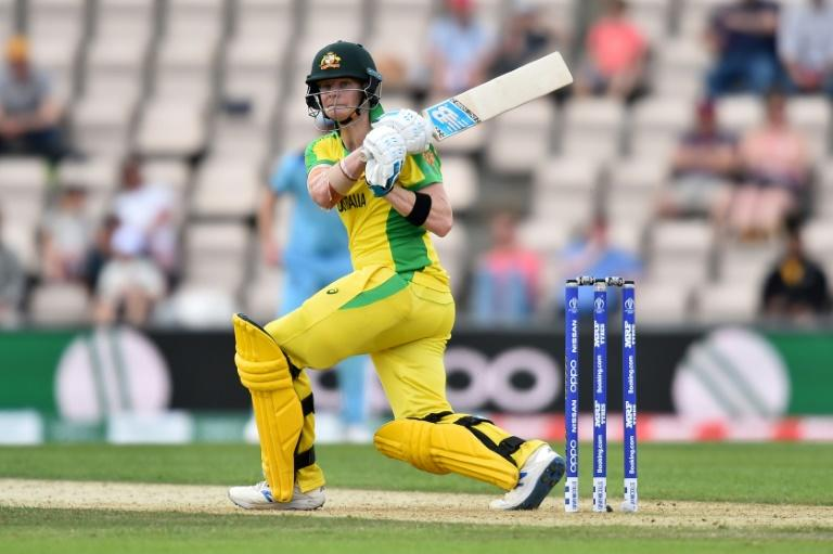 Jeers and cheers - Australia's Steve Smith hits out during his 116 against England in a World Cup warm-up match