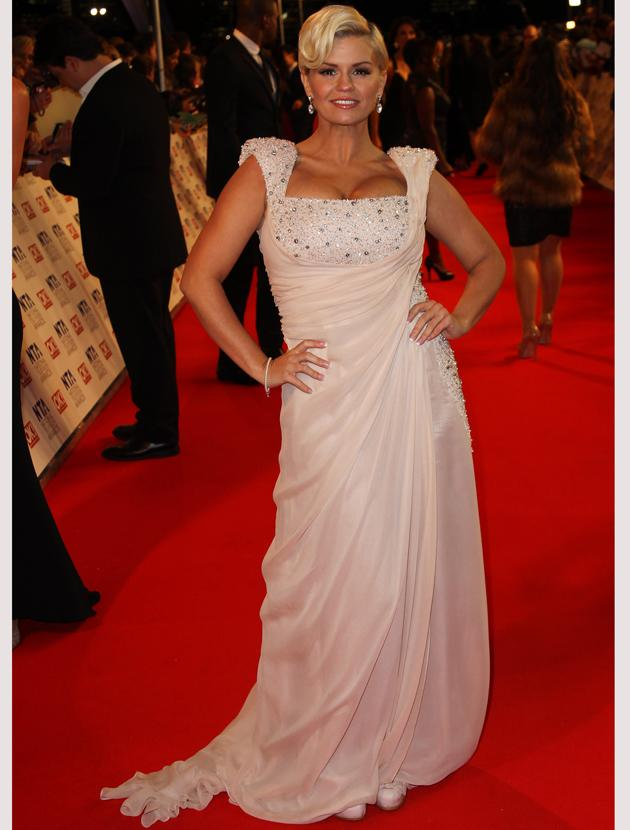National TV Awards 2012 photos: Kerry Katona looked pretty in peach with just the right scattering of sequins. She finished things off with a sweeping quiff and elegant earrings.