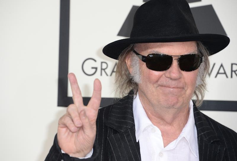 Neil Young arrives on the red carpet for the 56th Grammy Awards at the Staples Center in Los Angeles, California, January 26, 2014