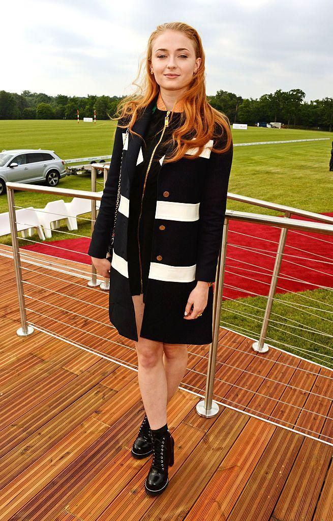 <p>The star enjoyed a day out at the polo at Coworth Park in a monochrome cardigan and dress.</p>