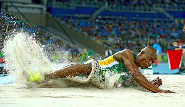 <p>Luvo Manyonga of South Africa competes in the Men's Long Jump Qualifying Round on Day 7 of the Rio 2016 Olympic Games at the Olympic Stadium on August 12, 2016 in Rio de Janeiro, Brazil. (Photo by Cameron Spencer/Getty Images) </p>