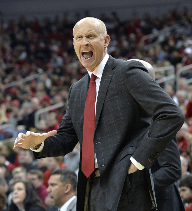 Louisville head coach Chris Mack argues a call with a game official during the first half of an NCAA college basketball game against Kent State in Louisville, Ky., Saturday, Dec. 15, 2018. (AP Photo/Timothy D. Easley)