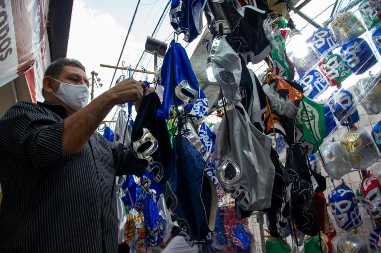 A seller arranges wrestling masks for sale outside the Arena Mexico in Mexico City; the return of pro wrestling has been a boon for nearby businesses