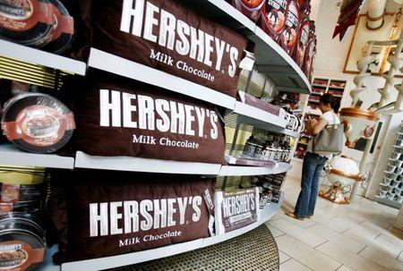 FILE PHOTO -  A woman shops inside the Hershey Store in New York
